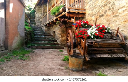 Asturias Scene Spain. Old Town Rustic. Cart With Flowers. Spanish Medieval Towns.
