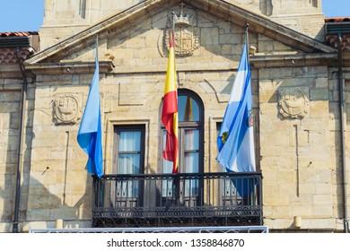Avilés, Asturias, Spain 03 31 2019 Avilés, Asturias and Spain flags in the balcony of the city hall