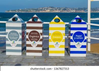 Gijón, Asturias, Spain 04 12 2019 Retro recycle bins in colours in San Lorenzo Beach in Gijón, Asturias inspired by vintage beach huts
