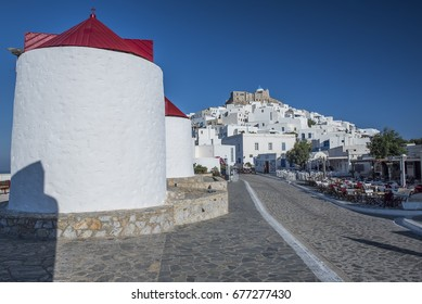 Astypalaia, Greece - August 21, 2015. View of the windmills with the town of Chora at the background, at the Greek island of Astypalaia in the Aegean Sea.
