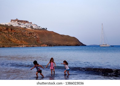 Astypalaia, Greece - May 27, 2014 : Children playing on a beach of Astypalaia Greece.