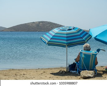 Astypalaia,Greece-August 2016.An old man enjoys the peaceful blue sea of Astypalaia,August 20th 2016
