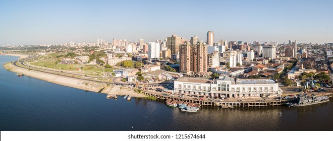 ASUNCION, PARAGUAY - July 13, 2018: Panoramic view of skyscrapers skyline of Latin American capital of Ciudad de Asunción Paraguay and Embankment of Paraguay river as seen in aerial drone photo.