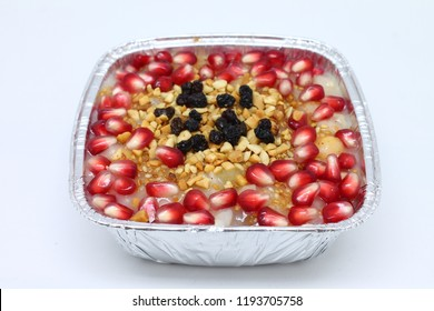 Asure (Noah's Pudding) Traditional Turkish, Islamic dessert in a colorful bowl on white background. Ashura is healthy.