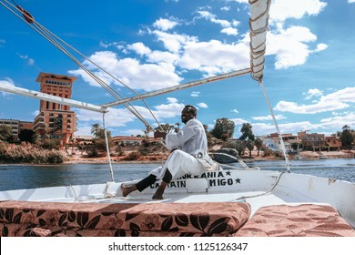 Aswan, Egypt: 2nd July 2018: A man controls his yacht by pulling the ropes.