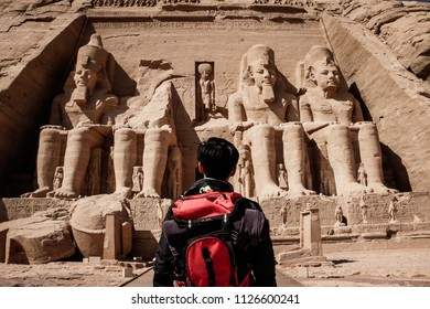 Aswan, Egypt: 4th July 2018: A man standing in front of Abu Simbel Temple.