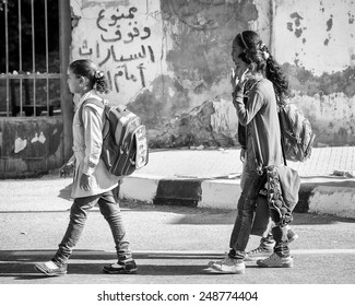 ASWAN, EGYPT - DEC 2, 2014: Unidentified Egyptian girls go to the school. 90% of Egyptian people are Muslim
