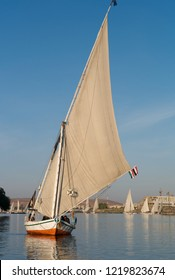ASWAN, EGYPT - JANUARY 3, 2011: A traditional Egyptian sailing boat called felucca cruising the river Nile near Aswan, Egypt.