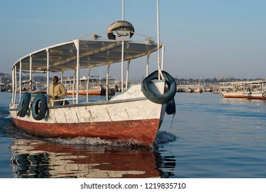 ASWAN, EGYPT - JANUARY 3, 2011: A small motorboat for tourists cruising the river Nile near Aswan, Egypt.