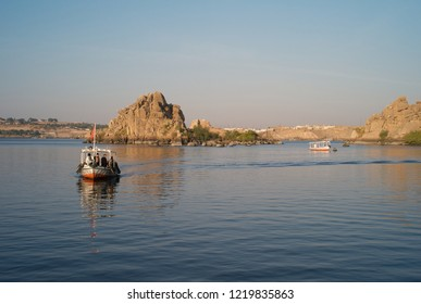 ASWAN, EGYPT - JANUARY 3, 2011: Two small motorboats for tourists cruising the river Nile near Aswan, Egypt.