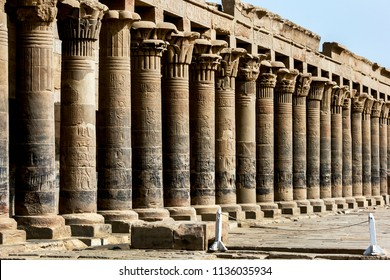 ASWAN, EGYPT - MAY 10, 2013 : The stone columns of the west colonnade at the outer temple court at Philae (Agilqiyya Island). Philae is also known as the Temple of Isis and dates from the 30th Dynasty