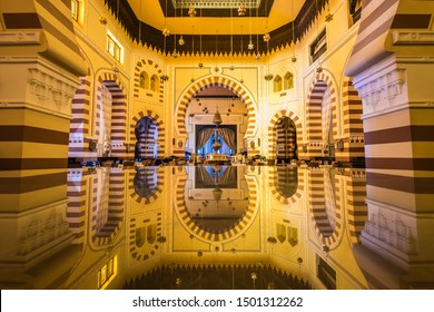 ASWAN, EGYPT - SEPTEMBER 03, 2017: Long exposure of the interior of the 1902 restaurant at the Old Cataract Hotel reflected in a glass table.