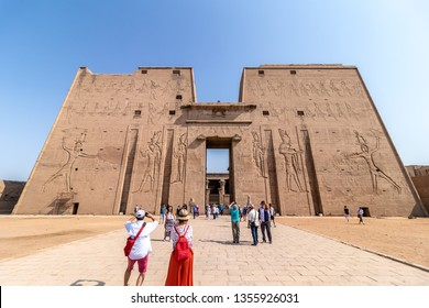 Aswan, Egypt - September 13, 2018: Tourists visiting the Edfu Temple. Dedicated to the Falcon God Horus, Located on the west bank of the Nile, Edfu, Upper Egypt