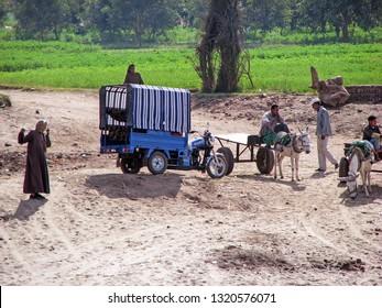 ASWAN, EGYPT-JAN. 11, 2009:  Egyptian farmers take a break from their work along the Nile River and their fertile farmland.