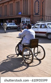 ASWAN,EGYPT - SEPTEMBER 21,2010:Big man rides on a homemade bike on the street in the city