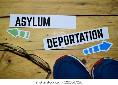 Asylum or Deportation opposite direction signs with sneakers and eyeglasses on wooden vintage background. Business and education concepts