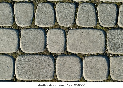 Asymmetric paving slabs of gray color, different size. Background