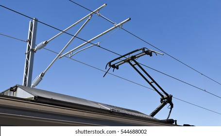An asymmetrical pantograph connecting the train to the overhead catenary wire.