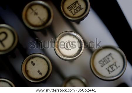 At Symbol On Old Typewriter Keyboard Stock Photo Edit Now 35062441