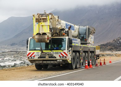 ATACAMA, CHILE - NOVEMBER 14, 2015: Heavy mobile crane Terex at the interurban road.