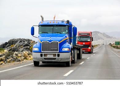 ATACAMA, CHILE - NOVEMBER 14, 2015: Blue semi-trailer truck Mack Vision at the interurban freeway throught the Atacama Desert (Ruta del Desierto).