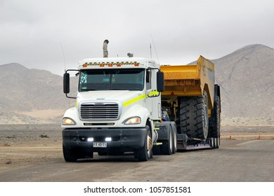 Atacama, Chile - November 18, 2015: Semi-trailer truck Freightliner Columbia at the interurban road near the Chanaral town.