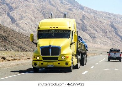 ATACAMA, CHILE - NOVEMBER 18, 2015: Yellow semi-trailer truck Kenworth T2000 at the interurban road.