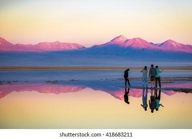 Atacama Desert, Chile - July 14th 2013 - Tourists enjoying a amazing colourful sunset in the Atacama Desert, northern Chile.