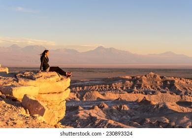 ATACAMA DESERT, CHILE - NOV 3, 2014: Unidentified tourist poses in the Atacama desert, Chile. Atacama Desert proper occupies 105,000 square kilometres