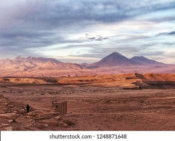 The Atacama desert as night begins to fall, with various mountains across the cordillera in the background. Taken outside of San Pedro de Atacama, Chile.