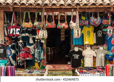 Ataco, El Salvador - August 9, 2014: A local small gift shop store front full of arts and crafts for sale.