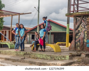 Atalaia do Norte, Brazil - September 21, 2018: Young people in blue school uniform on the street of village in the Amazon jungle. South America