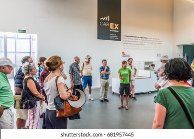 ATAPUERCA, SPAIN - JUNE 22, 2016: Tourists visiting the Centro de Arqueologia Experimental (CAREX) in the Archaeological Site of Atapuerca. The site is a UNESCO World Heritage Site.