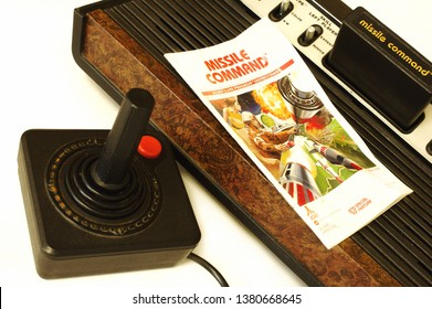 Atari 2600 with missile command game and instruction manual. On white background. Circa 1981. Illustrative editorial.