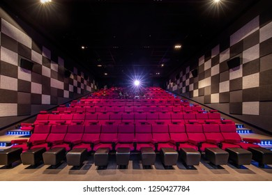 Atasehir, Istanbul, Turkey - November 24, 2018; Cinemaximum cinema in a shopping center in Istanbul. Movie Theater with empty seats and projector / High contrast image