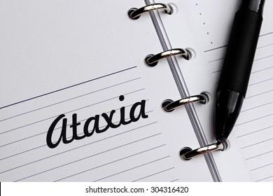 ATAXIA word written on notebook