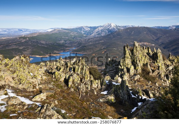 Atazar reservoir and Cabra peak from the Cabeza cliff in the Sierra Norte. Patones. Madrid. Spain. Europe.