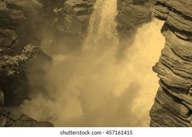 Athabasca Falls in Jasper National Park in Alberta Canada - vintage sepia look
