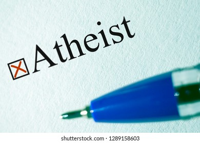 Atheist - checkbox with a cross, white paper with pen. Checklist concept