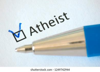 Atheist checkbox on white paper with pen. Checklist concept.