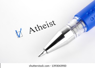 Atheist. Filling in the questionnaire, documents. The checkboxes are filled with a black pen on a white background. Questionnaire, survey.