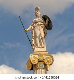 Athena the goddess of knowledge and wisdom marble statue on Ionic column and partly cloudy sky
