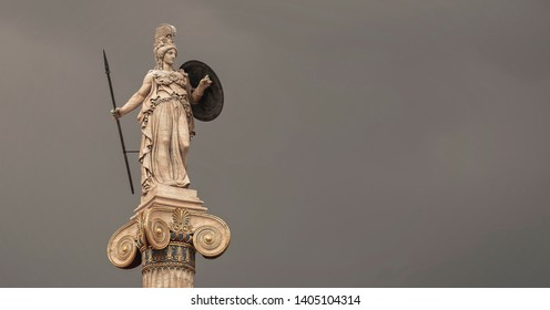 Athena goddess marble statue with spear and shield isolated on dark grey sky background, lots of space for text
