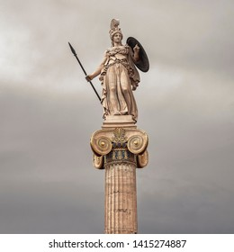 Athena goddess marble statue with spear and shield isolated on grey sky background