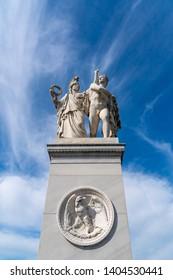 """Athena Leads the Young Warrior into the Fight (""""Der Jüngling wird von Athena in neuen Kampf geführt"""") is an 1853 sculpture by Albert Wolff, installed on Schlossbrücke in Berlin, Germany."""