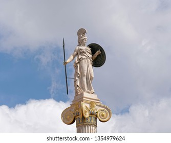 Athena marble statue  the ancient Greek goddess of knowledge and wisdom, under blue sky with clouds