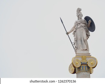 Athena marble statue isolated on almost white sky background, space for text
