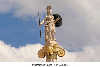 Athena marble statue on Ionic column and partly cloudy sky, space for text