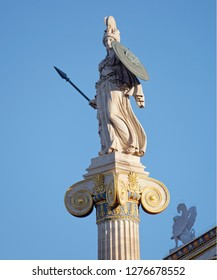 Athena and small sphinx statue under blue sky background, Athens Greece