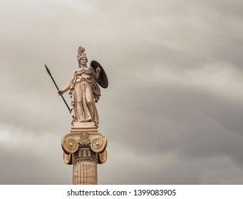 Athena statue, the ancient greek goddess of science and wisdom, isolated on dark grey sky background, filtered image